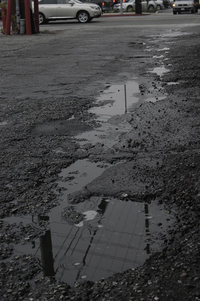 Before- Photo of rainy alley by Sebastian Bleak
