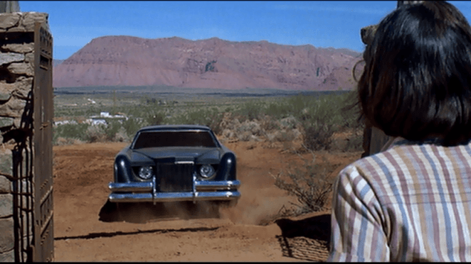 The titular Car stares down a group of teachers supposedly safe on hallowed ground.