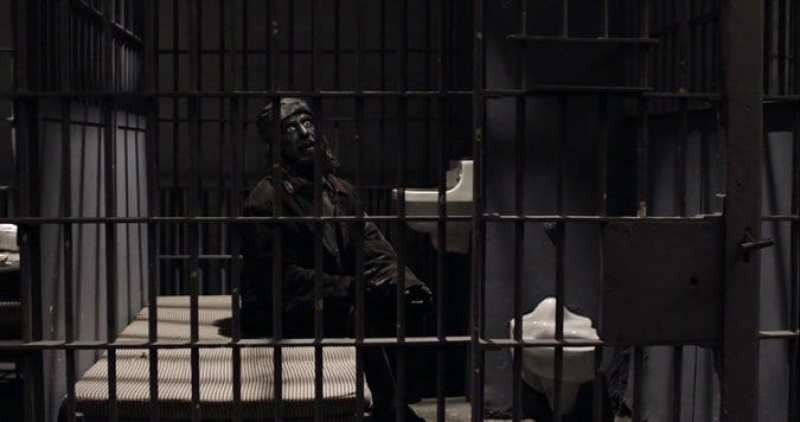 A completely blackened Woodsman in a prison cell Twin Peaks S3