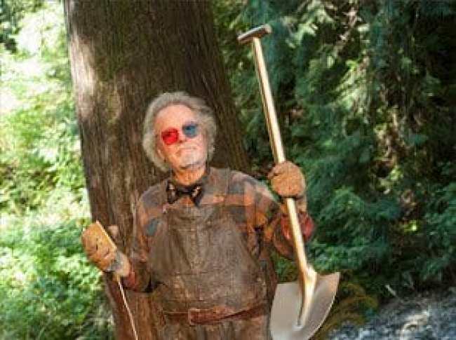 Dr Jacoby holds a golden shovel