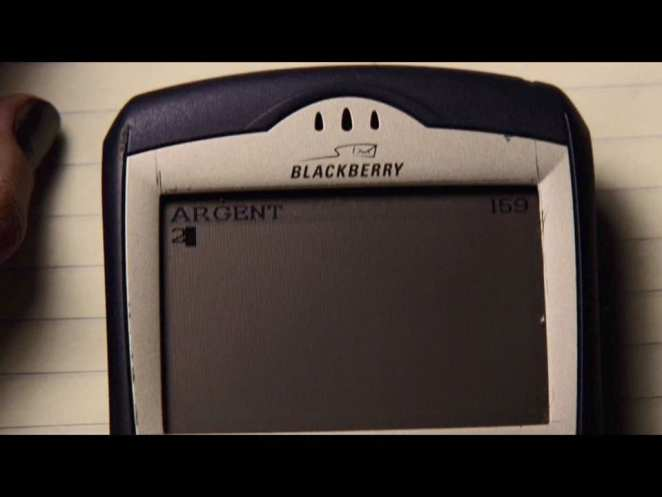 A Blackberry cell phone with the word Argent 2 on the screen