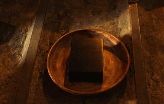 A strange black box in a bowl used for sifting for gold