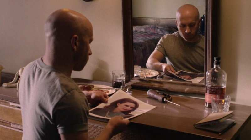 Ike the Spike looks at a picture of Lorraine and is reflected in a mirror