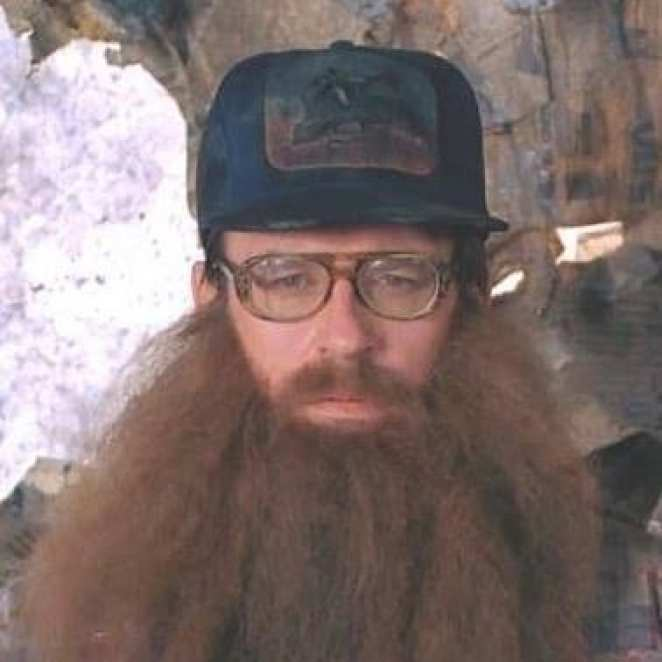 Second Woodsman in Fire Walk With Me with cap, beard and glasses