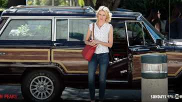 Janey E stands by her SUV like a boss