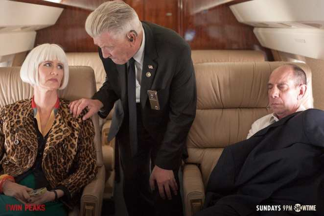 Gordon touches the shoulder of Diane and Albert sleeps on a plane in Twin Peaks