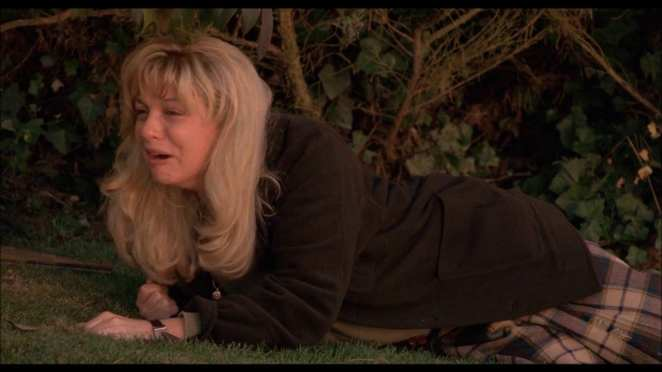 Laura Palmer discovers that BOB is really her father and hides in the bushes of her garden