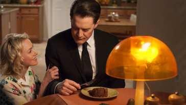 Janey E strokes Dougies arm as he eats chocolate cake