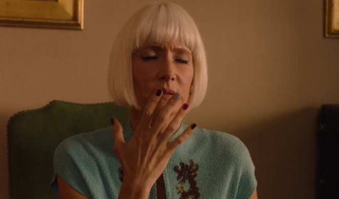 Diane closes her eyes and raises her hand to her face as she remembers what Mr C did to her