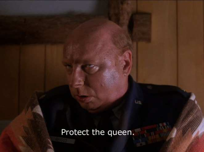Briggs tells Cooper to protect the queen