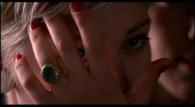 teresa banks wearing the green and gold owl ring on her left ring finger