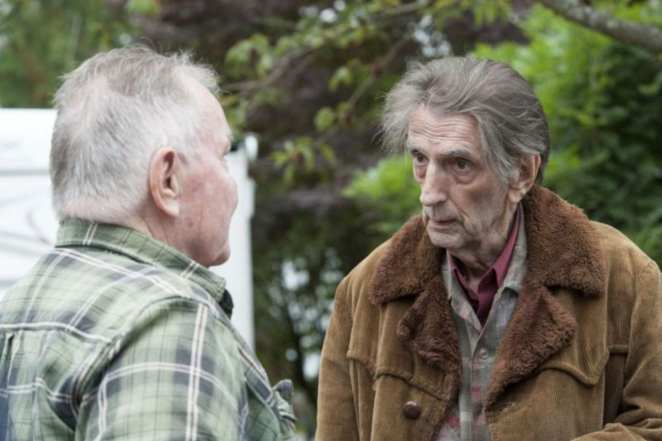 Carl Rodd speaks to a resident of the fat trout trailer park about selling his blood