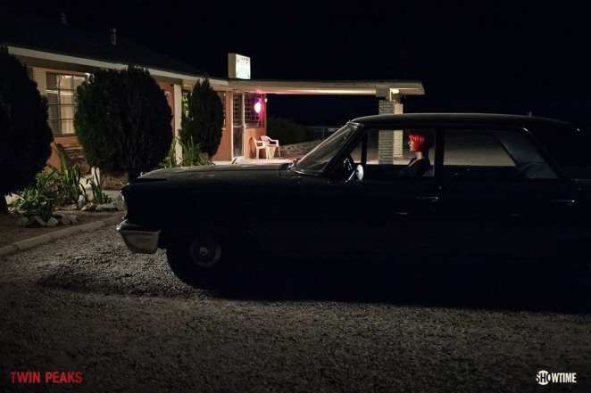 Diane sits in a vehicle outside a motel