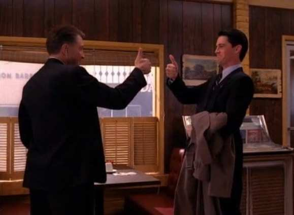 Gordon Cole and Dale Cooper give each other a thumbs up in the Double R Diner