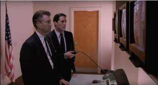 Gordon and Cooper watch video footage of Jeffries arrival at Philadelphia offices