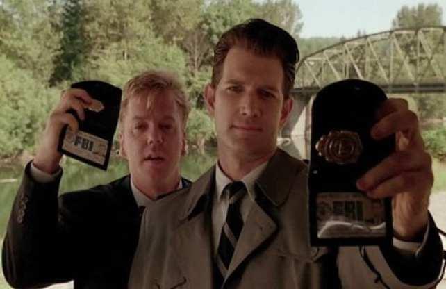 chet desmond and sam stanley hold up their fbi identification badges