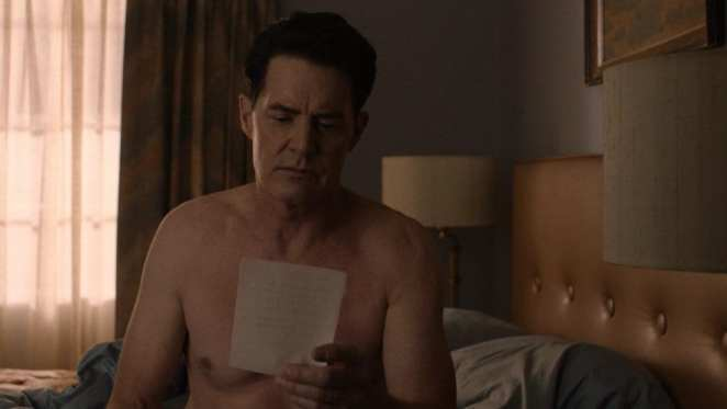 cooper or richard reads a letter from diane in his motel room