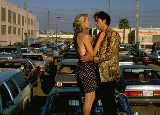 sailor sings love me tender to lula on a car bonnet in wild at heart