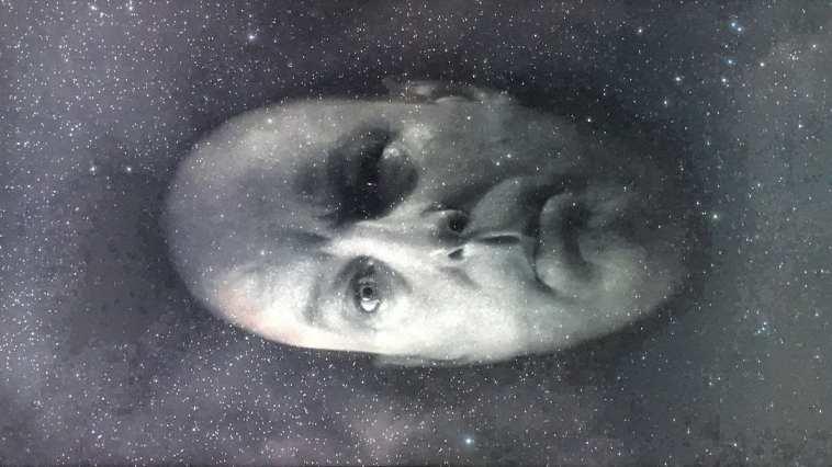 Major Briggs' head floats through space