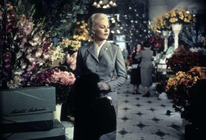 a platinum blonde woman in a florist in Vertigo