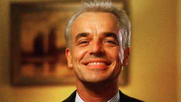 Leland Palmer grins at himself in a mirror