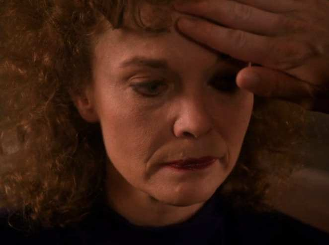 Cooper feels Sarah Palmers forehead