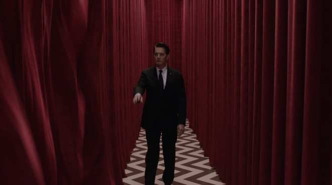 Cooper raises his arm in the black lodge and the curtains flow open