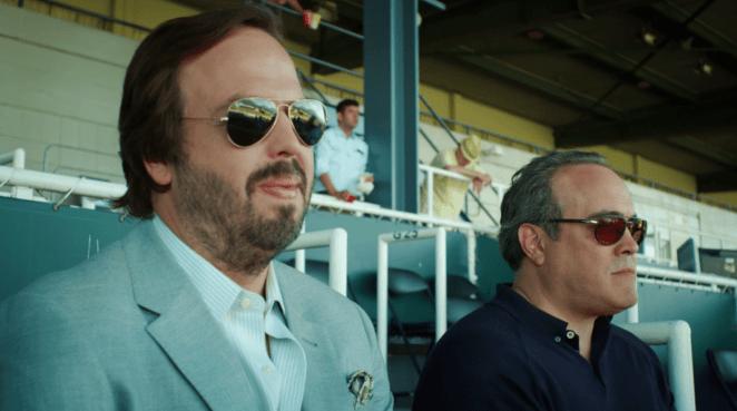 two men wearing shades at ball game in Shut Eye