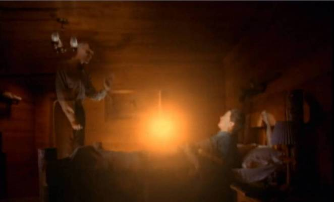 The Giant sends a golden orb from himself to Dale Cooper, who is laying in his bed in the Great Northern.