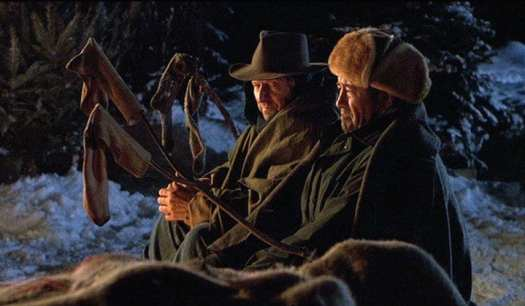Holling and Maurice sit at a campfire