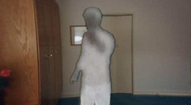 Joe is a blurry silhouette after Beth blocks him