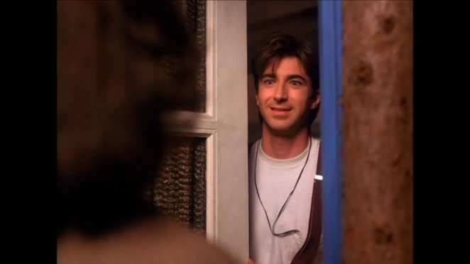 Harold Smith smiles as he opens his door to Donna