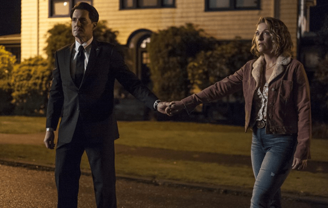 Cooper and Carrie hold hands outside the Palmer house