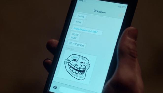 Trollface appears on Kenny's phone