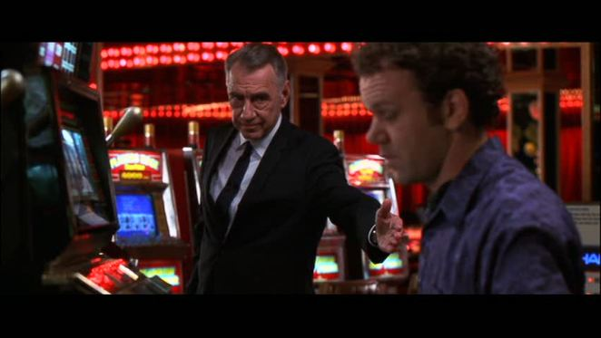 Phillip Baker Hall reaches a hand out to John C Reilly in a casino in Hard Eight