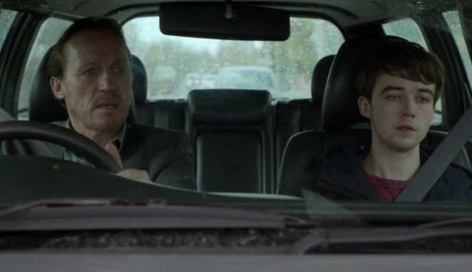 Hector and Kenny sit in a car
