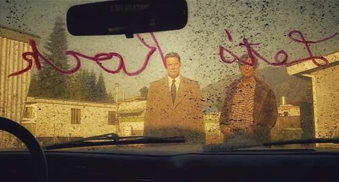 cooper and carl rodd look at the dirty car windscreen with Let's Rock written on it