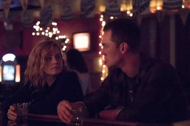 Camille and John share a drink at the bar in Sharp Objects