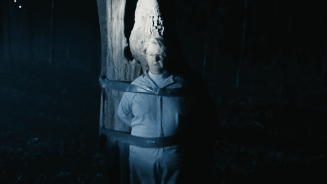 Gladys is tied to a tree in the night before being killed