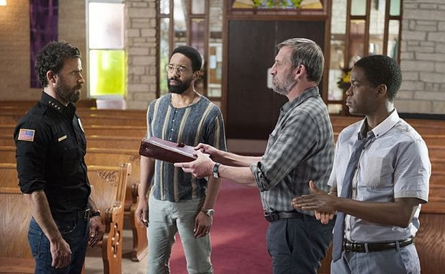 Matt offers the Book of Kevin to Kevin as John Murphy and his son look on