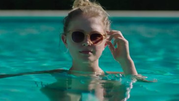 Amma in a swimming pool with sunglasses on in Sharp Objects