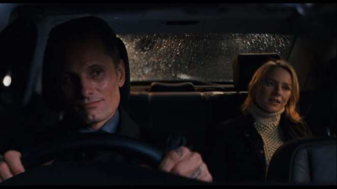 Naomi Watts rides in the back of a car with Vigoo Mortensen driving in Eastern Promises