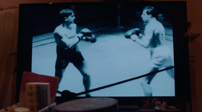 Shot of a boxing match on the TV