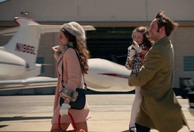 pete with his wife and child running for a plane