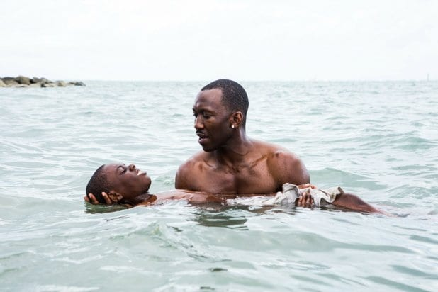 Mahershala Ali as Juan in Moonlight teaches a boy how to swim in the sea