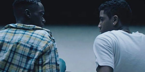 Ashton Sanders as Teen Chiron talking to his friend in Moonlight
