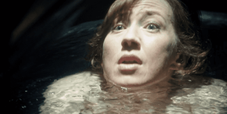 Nora has her head just above water as she prepares for the procedure that is supposed to transport her