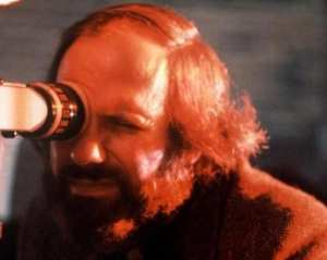 Brian De Palma works behinds the scenes to craft another scene.