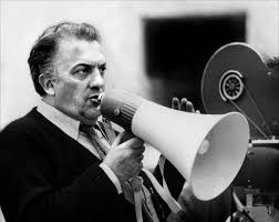 Federico Fellini uses a bullhorn to set up his next shot.