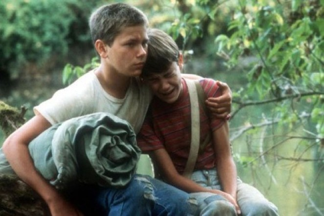 river phoenix comforts his friend with a hug